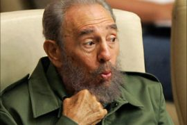r_Cuba's President Fidel Castro reacts to a speaker during the closing ceremony of a seminar on literacy in Havana, June 9, 2006