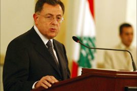 f_Lebanese Prime Minister Fuad Siniora speaks during a press conference in Beirut, 19 July 2006 at Beirut's port. An embittered Siniora called for the international community to send urgent humanitarian aid and to work for a ceasefire