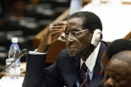 Zimbabwe's President Robert Mugabe closes his eyes as he listens to the closing statement from acting Cuban President Raul Castro at the summit for Non-Aligned nations in Havana