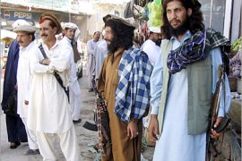REUTERS/  Pakistani Taliban militants stand guard in a busy market in Miranshah, the main town in north Waziristan border region, October 18, 2006. Mujahideen, or holy warriors, flocked to