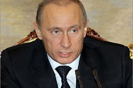 r_Russian President Vladimir Putin speaks during a discussion devoted to ensuring enough gas and electricity supply for Russia's growing economy as a mid-term perspective