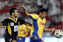 AFP /  Qatari al-Gharafa club's Yunes Mahmud (L) of Iraq vies with Khaled Salehof of Qatar club during their Qatari championship football match in Doha, 18 November 2006.