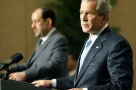 US President George W. Bush (R) and Iraqi Prime Minister Nouri Maliki hold a joint press conference at the Four Seasons Hotel in Amman, Jordan, 30 November 2006