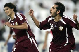 r_Qatar's Adel Lamy (R) and Sebastian Quintana celebrates after scoring against Jordan during their 15th Asian Games Group A second round soccer match in Doha November