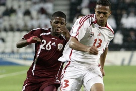 AFP/Qatar national team player and AFC's player of the year, Khalfan Ibrahim, (L) vies with Talal al-Junaibi of the United Arab Emirates (R) during the men's round 2 group A football match at the Al-Sadd Football Stadium during the 15th Asian Games in Doha 05 December 2006.