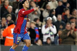 REUTERS/  Barcelona's Ronaldinho celebrates scoring against Real Sociedad during their Spanish First Division soccer match at Nou Camp stadium in Barcelona December 9, 2006.
