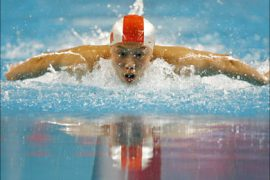 r_China's Qi Hui swims without goggles during the women's 200m individual medley swimming finals competition in Doha December 7, 2006. Qi took the gold medal.  REUTERS/Jerry Lampen  (QATAR)
