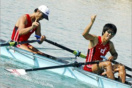AFP /  Team Japan celebrates after winning the gold medal in the Men's Lightweight Double Sculls Rowing Competition at the West Bay Lagoon during the 15th Asian Games in Doha, 06