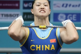 AFP/China's world champion Cao Lei competes in the 75kg category in women's weightlifting at the 15th Asian Games in Doha, 05 December 2006.