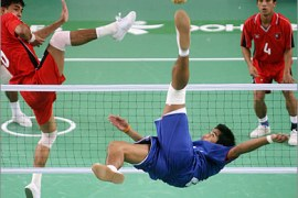 AFP/Thailand's player Pornchai Kaokaew (C-blue) returns the ball to the Myanmar team during the semi-final of the men sepaktakraw at Al-Sadd Sports Club during the 15th Asian Games Doha