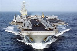 f_This 14 April, 2000 US Navy file photo shows the aircaft carrier USS Dwight D. Eisenhower (CVN 69) transiting the Atlantic Ocean on its way to start a six-month deployment