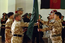 Outgoing commander of the International Security Assistance Force (ISAF) British General David Richards (R) receives the ISAF flag from an unidentified soldier while German General Egon Ramms (2R) and incoming US Army General Dan K. McNeill (3R) look on during the change of command ceremony at ISAF headquarters in Kabul, 04 February 2007