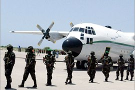 AFP  /  Some of the first African Union peacekeepers from Uganda land in the lawless Somali capital's airport, in Mogadishu 06 March 2007. The Ugandans are the first part of a planned