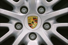f_the logo of German carmaker Porsche in a rim of a 2007 model displayed at the South Florida International Auto Show
