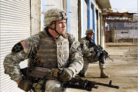 AFP / A picture released by the US military, 12 April 2007 shows US Army Spc. Douglas Harlan (L), and a fellow soldier conducting a cordon and search for weapons caches and