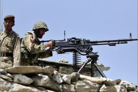AFP/Pakistani Army soldiers take position at Sholam Post, a military checkpost overlooking Wana,
