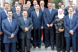 AFP  – Yemeni President Ali Abdullah Saleh (C-L) poses for a souvenir photo with new Prime Minister Ali Mohammed Mujawar (C-R) and the ministers of the new Yemeni government after taking the oath at the presidential palace in Sanaa, 07 April 2007. Yemeni President Ali Abdullah Saleh named this week the new ministerial line-up marked by the