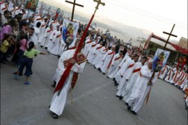 afp : Egyptian Copts parade during celebrations for the Feast of Assumption, marking the Virgin Mary's ascension into heaven, late 20 August 2007 in Doronka village, outside