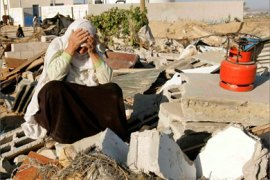 A Palestinian woman reacts over the rubble of her house after local witnesses said was demolished by an Israeli bulldozer in the southern Gaza Strip November 8, 2007.
