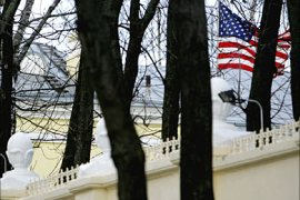 f_The US national flag flies behind a fence of the embassy of USA in Minsk on March 07, 2008. Belarus on Friday asked the US ambassador to leave the country and recalled its own