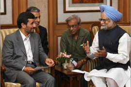 AFP\Indian Prime Minister Manmohan Singh (R) talks with Iranian President Mahmoud Ahmadinejad (L) during a meeting at the Prime Minister's