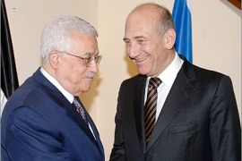 AFP/ A handout picture released by the Israeli government press office shows Israeli Prime Minister Ehud Olmert (R) shaking hands with Palestinian president Mahmud Abbas during a meeting in Jerusalem on May 5, 2008. Olmert and Abbas