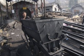 A rescuer prepares to go down Guaziyan coal mine where a gas blast occurred in Lianyuan, Hunan province December 18, 2008