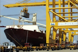 AFP (FILES) A cargo ship is docked on March 14, 2006 at Dubai's Jebel Ali port, managed by state-owned Dubai Ports World (DP World). DP World announced on March 25, 2009, a 48 percent growth in last year's profits, though the company