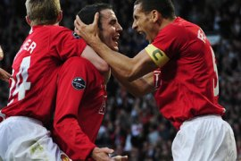 Manchester United's John O'Shea (C) celebrates with Darren Fletcher (L) and Rio Ferdinand (R) after scoring during their Champions League semi-final, first leg soccer