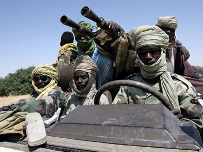 afp/ (FILES) — File pictures dated October 17, 2007 shows fighters of the Sudanese Justice and Equality Movement (JEM) driving their armoured battle wagon at an unknown location on the Sudan-Chad border in northwest Darfur.