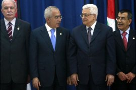 r : Palestinian President Mahmoud Abbas (C) stands with newly sworn in members of the cabinet (from L) Foreign Minister Riyad al-Malki, Prime Minister Salam Fayyad, Interior