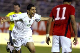 epa : epa01755039 Algeria's Karim Matmour celebrates after scoring against Egypt during their African Zone World Cup 2010 qualifying soccer match in Blida, Algeria in Blida 50 km