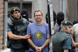 Spanish Civil Guards lead away arrested lawyer Inaki Golloaga (2nd L) during an operation in Bilbao June 13, 2009. Spanish authorities have foiled a plot by ETA members to