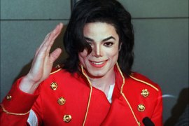 US pop star Michael Jackson waves to photographers during a press conference in Paris on March 19, 1996. Michael Jackson died on June 25, 2009 after