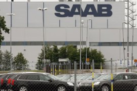New Saab automobiles are parked in a storage lot outside the main Saab factory in Trollhattan June 10, 2009. General Motors Corp' Saab Automobile unit has narrowed talks