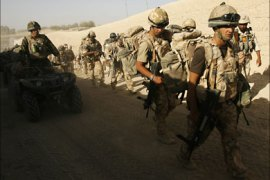 British soldiers from B Company, 2 Mercian set off on an operation in Malgir, Helmand province July 27, 2009.  REUTERS