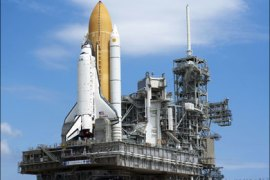 afp : CAPE CANAVERAL, FL – AUGUST 4: Space Shuttle Discovery, sitting atop the crawler transporter, rolls out to launch pad 39-A at the Kennedy Space Center August 4,