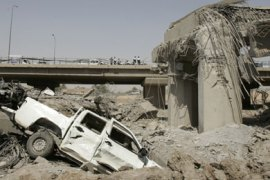 A collapsed highway is seen after a truck bomb attack targeting the Iraqi Finance Ministry in Baghdad August 19, 2009. A series of explosions killed at least 75 people