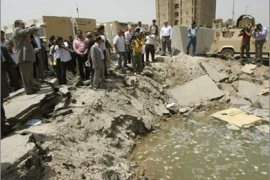 Iraqi Foreign Minister Hoshyar Zebari (pointing left) visits on August 23, 2009 the site of a massive truck bomb which detonated outside the foreign ministry building earlier in the week in central Baghdad. Zebari alleged there had been collaboration between