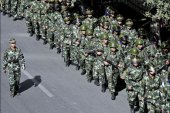 afp : Chinese troops march along a street of Urumqi, the capital of the Xinjiang Uyghur autonomous region, on September 5, 2009. Some Han Chinese residents have