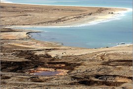 A picture shows the drying shores of the Dead Sea, south of the Jordanian capital Amman, on November 9, 2009. The Dead Sea may soon shrink to a lifeless pond as Middle East political strife blocks vital measures needed to halt the decay of the world's lowest and saltiest body of water, experts say