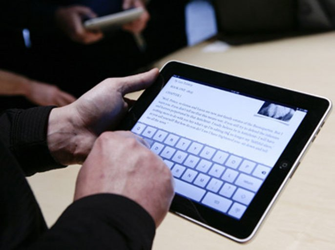 Event guests play with the new Apple iPad during an Apple Special Event at Yerba Buena Center for the Arts January 27, 2010 in San Francisco, California. CEO Steve Jobs and Apple Inc. introduced its latest creation, the iPad, a mobile tablet browsing device that is a cross between the iPhone and a MacBook laptop.