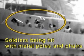 "An image grab taken from a video released by the Israeli navy shows, according to the Israeli military, passengers of Turkish aid ship Mavi Marmara, one of the ships in the ""Freedom Flotilla"", attacking Israeli soldiers who raided the ship in international waters on May 31, 2010"