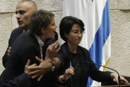 Israeli Arab Knesset member Hanin Zoabi (R), who was on board the Marmara ship when it was raided by the Israeli Navy, is interrupted by fellow MPs as she addresses a stormy parliamentary session in Jerusalem on June 2, 2010 dedicated to the deadly Israeli raid on a Gaza-bound aid flotilla earlier this week.