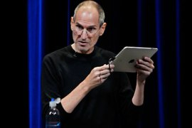r_Apple Chief Executive Steve Jobs uses an iPad to run Apple TV as he speaks on stage at Apple's music-themed September media event in San Francisco, California