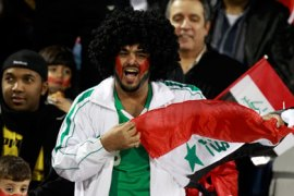 An Iraq fan cheers before their 2011 Asian Cup Group D soccer match against Iran at Al Rayyan stadium in Doha January 11, 2011.