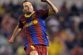 Barcelona's midfielder Andres Iniesta celebrates after scoring against Deportivo during the Spanish league football match RC Deportivo de la Coruna vs Barcelona FC on January 8, 2011 at Municipal