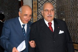 Interim Tunisian President Fouad Mbazaa (R) and Prime minister Mohamed Ghannouchi (L) speak as they arrive at the Government Palace, in Tunis on January 17, 2011.  Tunisian protesters called for the abolition of ousted president Zine El Abidine Ben Ali's ruling party amid a chaotic power vacuum as politicians prepared a government of national unity.