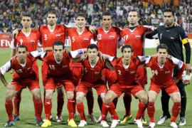 Syria's national soccer team poses for a group picture before their 2011 Asian Cup Group B soccer match against Japan at Qatar Sports Club stadium in Doha January 13, 2011. From L-R (bottom row) Samer Aouad, Nadim Sabag, Jehad Al Hussien, Belal Abduldaim, Wael Ayan, (top row) Abdulrazak Al Husein, Ali Dyab, Feras Ismail, Mohamad Al Zino, Abulkader Deka and Mosab Balhous.