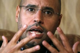 Libyan leader Muammar Gaddafi's most prominent son, Saif al-Islam, speaks during an interview with Reuters in Tripoli March 10, 2011. Libya is preparing full-scale military action to crush a rebellion and will not surrender even if Western powers intervene in the conflict, al-Islam said on Thursday. REUTERS